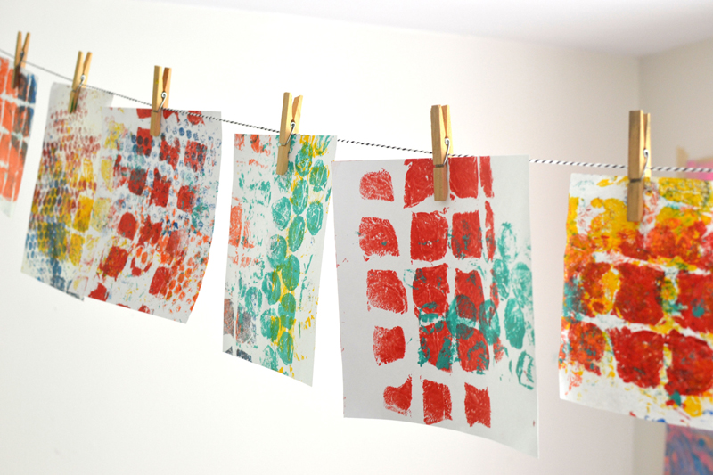 Kids use rollers and tempera paint to make print from the bubble wrap tree.