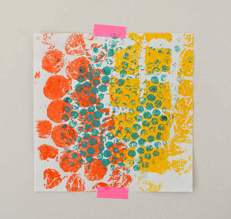 Kids use rollers and tempera paint to make print from the bubble wrap tree