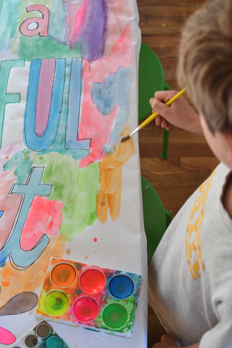 make a table banner with watercolors for Thanksgiving day where everyone can collaborate and contribute