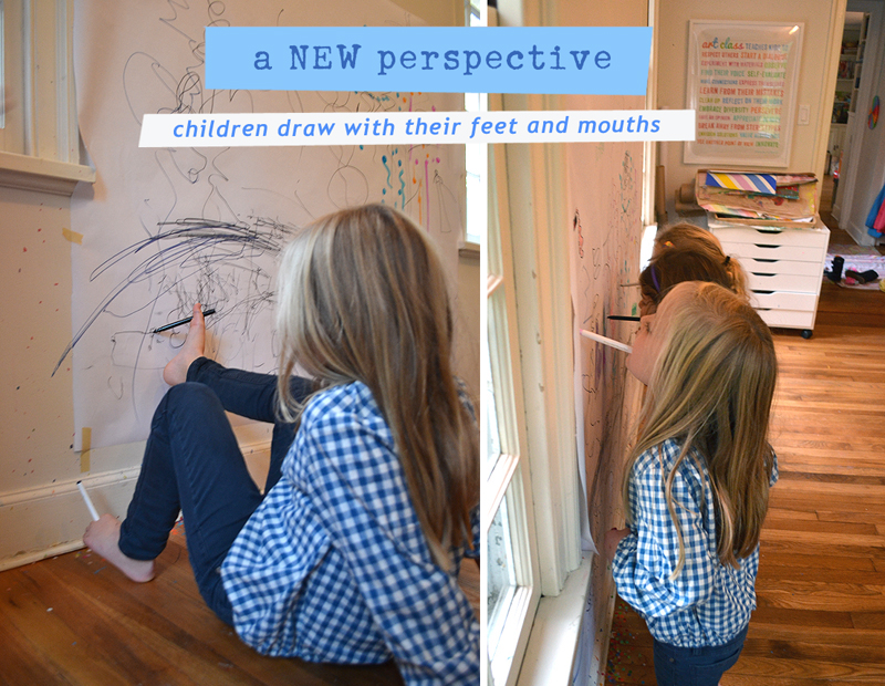 Children use their feet to draw, opening their world to a different perspective