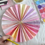 Paint handmade paper pinwheels with watercolors