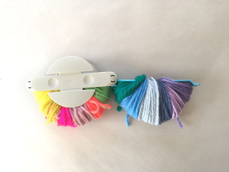 Make an (almost) perfect rainbow pom-pom with this simple DIY.
