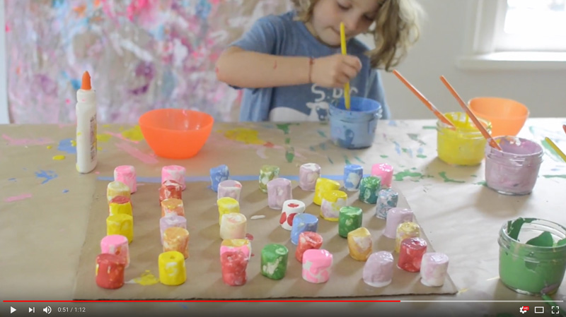 Video of children collaborating to make a painting from marshmallows