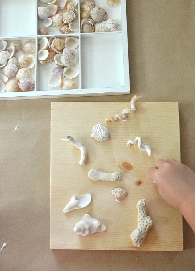 Seashell collages by kids, using tacky glue and liquid watercolor.