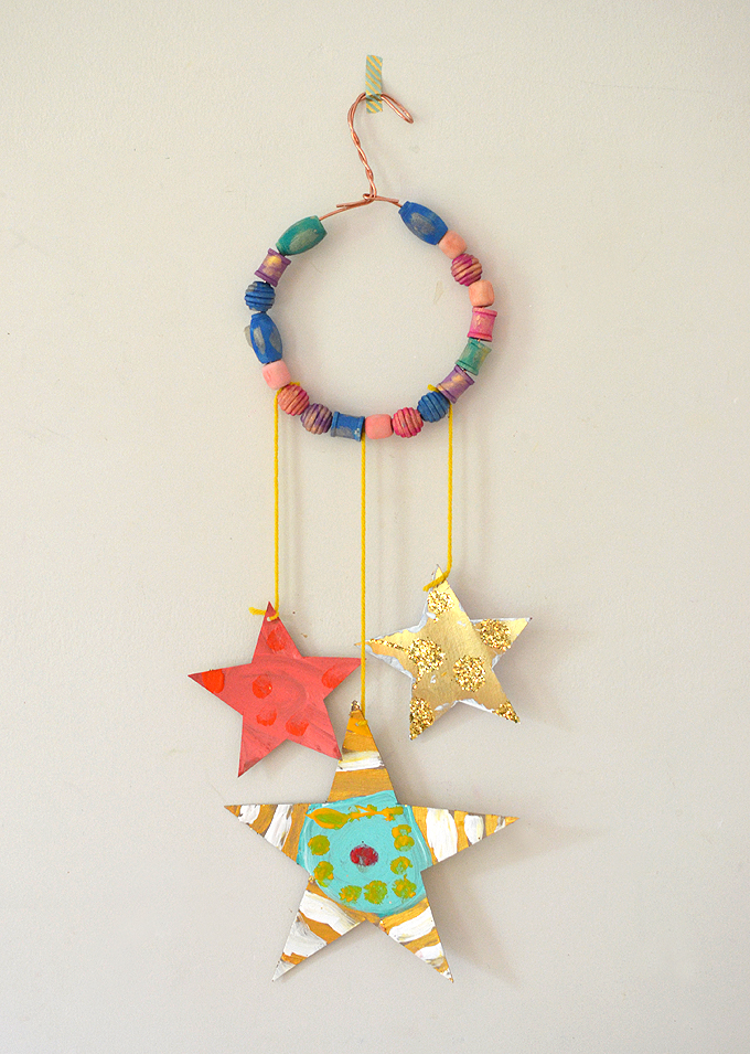 Glitter star mobiles made with cereal box cardboard.