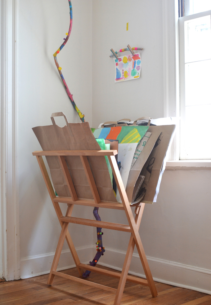 Make paper bag portfolios (with built in handles) for your children's art, then use this magazine rack to store the portfolios.