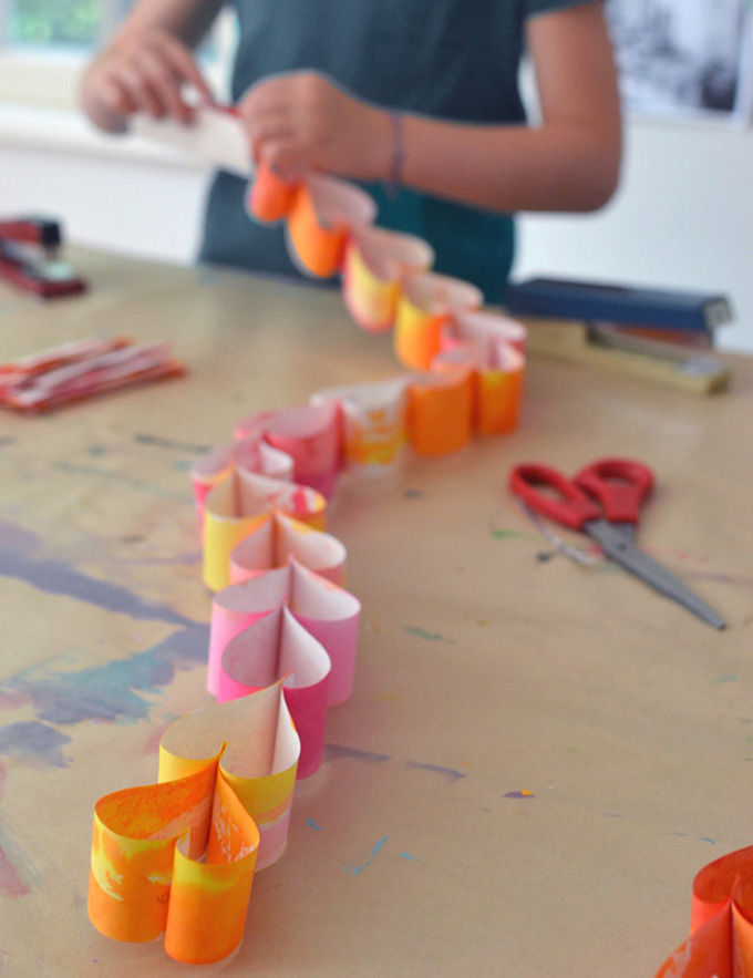 Fold paper into hearts and make a paper chain. Perfect craft for teens and tweens.