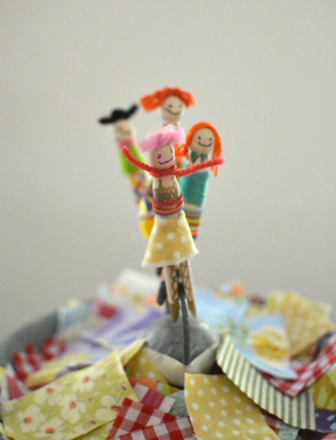 Kids make people from wooden clothespin pegs, yarn and fabric scraps.