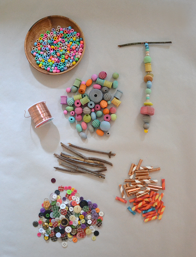 Supplies for wooden bead mobiles using wire and twigs.