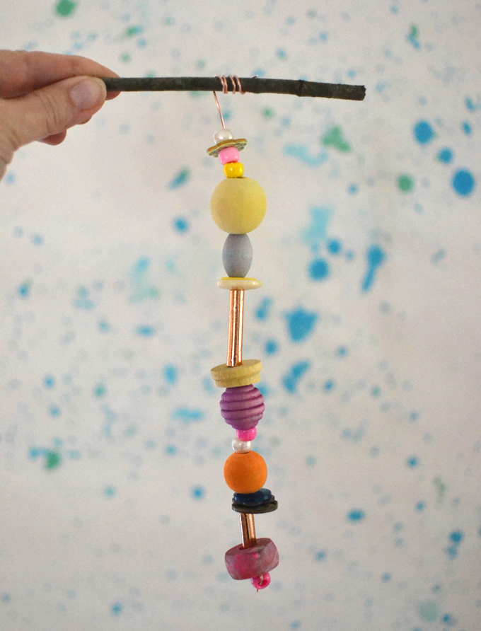 Make wooden bead mobiles using wire and twigs.