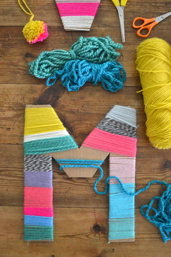 Wrap yarn around cardboard letters to make a colorful, decorative piece of art. A perfect craft for kindergartners through to teens and tweens.