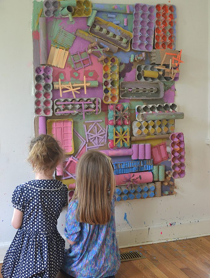 Using recycled materials, kids create a giant assemblage structure that they paint with colors they mixed themselves. Excellent process art experience.