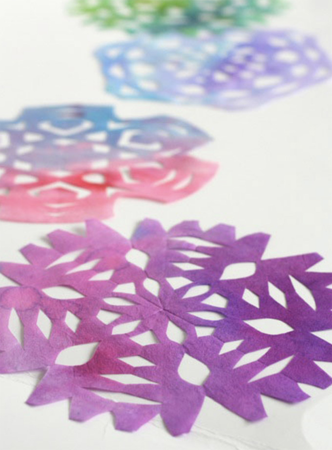 Painting snowflakes with food coloring.