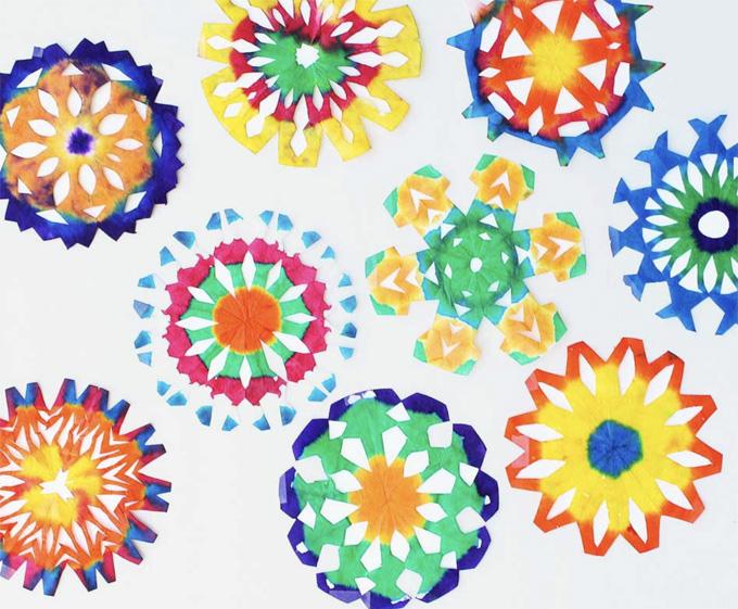 Tie-die snowflakes using a dip-dye technique.
