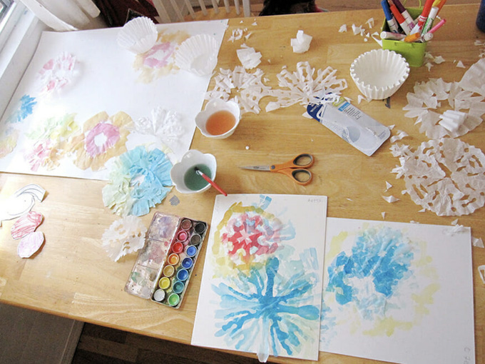 Painting coffee filter snowflakes with watercolors.