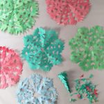 Snowflakes made from painted coffee filters.
