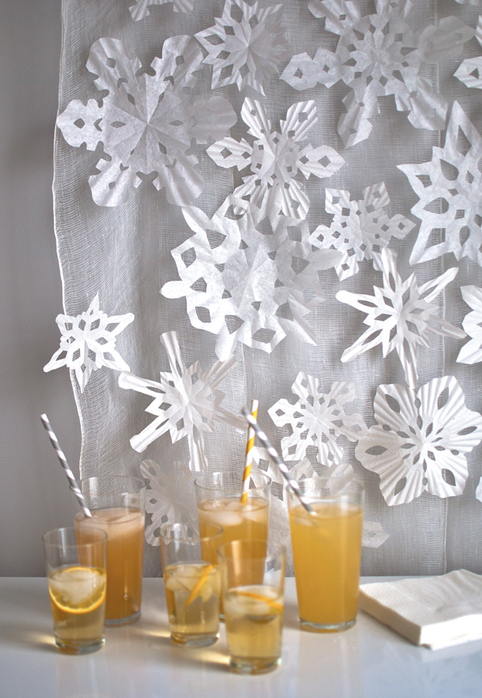 Making snowflakes from coffee filters and cupcake liners.