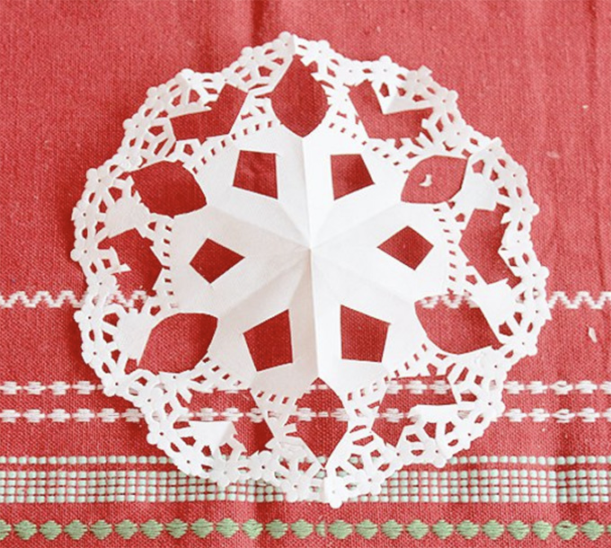 Make snowflakes from doilies.