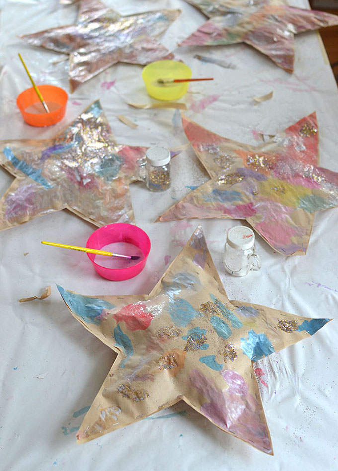 Kids make puffy stars with paper and paint.