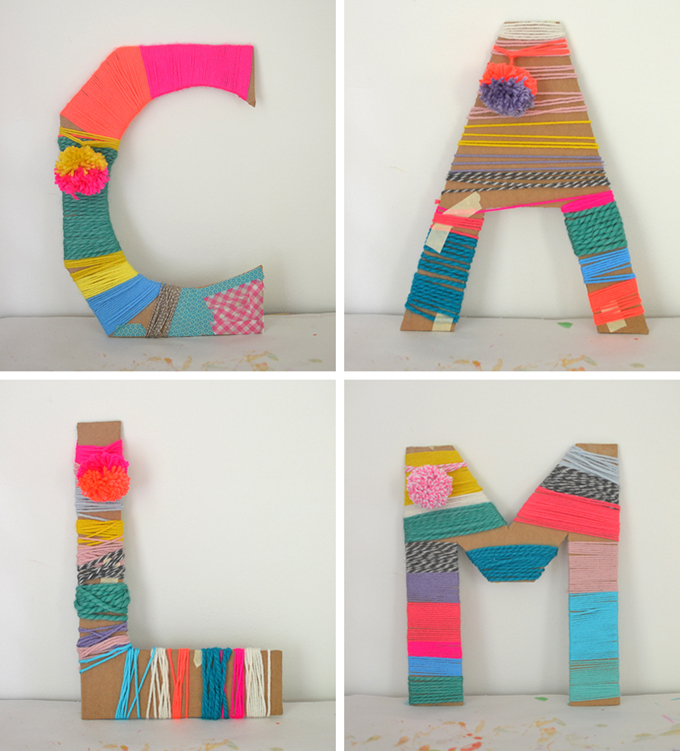Kids wrap yarn around cardboard letters.