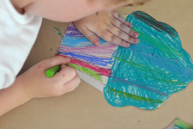 Kids use cereal box cardboard and oil pastels to make these artsy cupcakes!