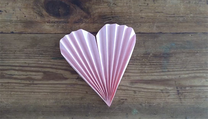 One-minute folded paper hearts. Make a garland, necklace, or fan. Or send in the mail for Valentine's Day!