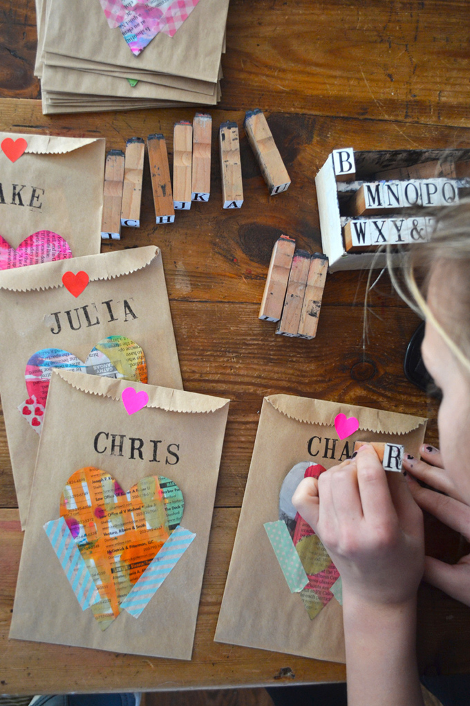 Kids make Valentine's for the class from newspaper hearts and little brown bags.