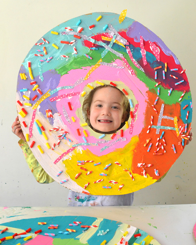 Kids make giant donuts from cardboard.