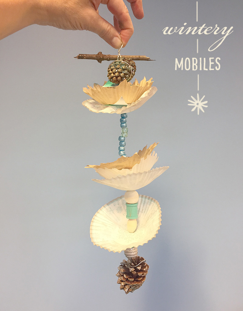 Kids make mobiles from wire, cupcake liners, beads, and pinecones.