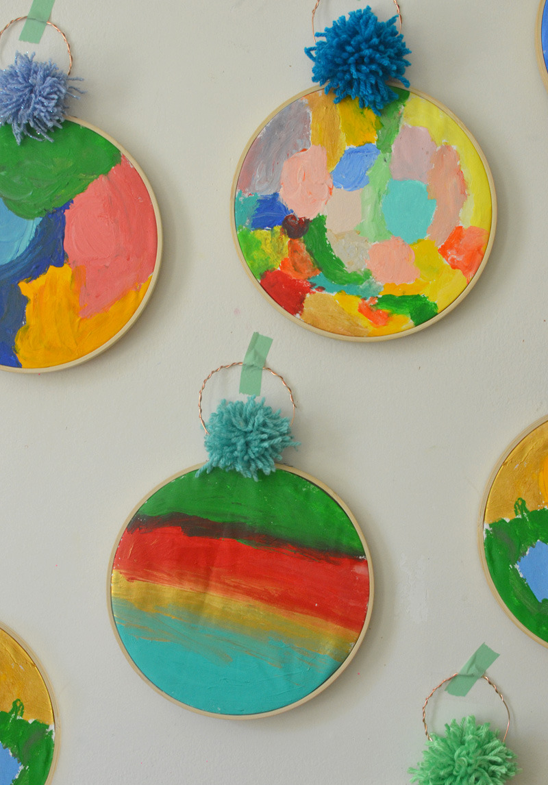 Acrylic painting with kids on fabric, framed with an embroidery hoop.
