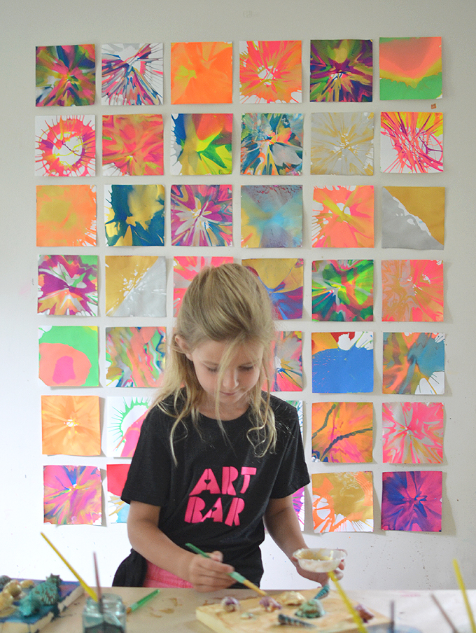 Make spin art with kids then hang them on the wall to make a really cool backdrop.