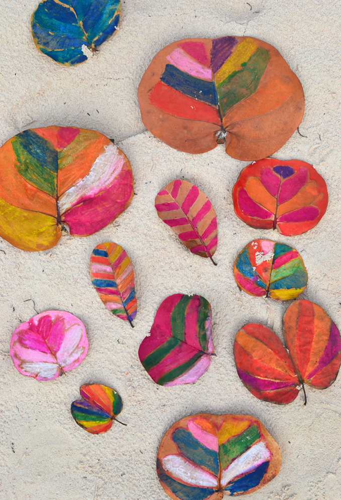 Paint leaves with water soluble crayons.