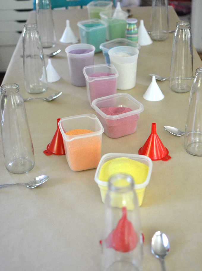 Dye sand from the beach for kids to make sand art in tall, pear juice bottles.