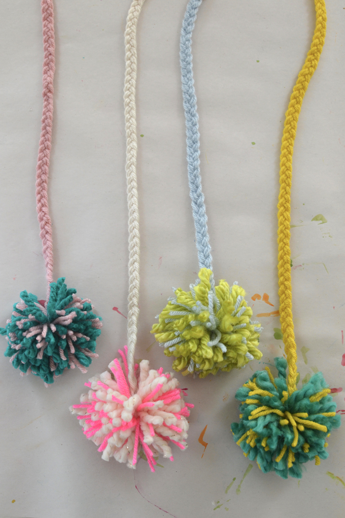 Make your own pom-pom loom from cardboard and follow this tutorial to create this charming mobile using easy supplies and simple skills.