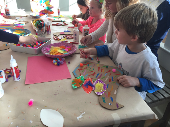Kids make the turkey craft from cardboard at a birthday party. Great art idea for Thanksgiving, too!