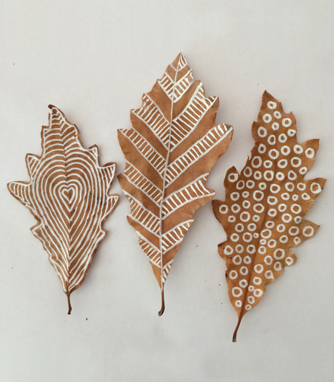 Drawing on leaves with white chalk markers is fun for all ages!