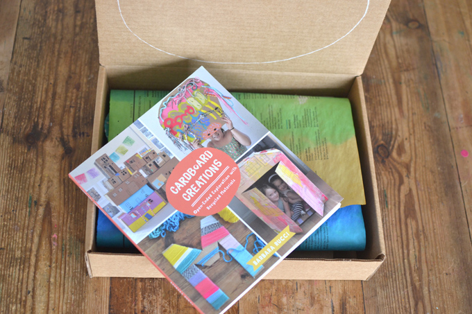 Make this open-ended, DIY art kit with cardboard, recycled materials, collage bits, and more. Easy and cheap!