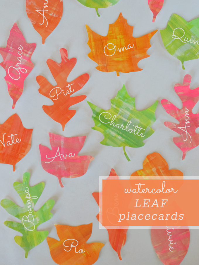 DIY leaf placecards for Thanksgiving made with watercolors and free printable stencils.