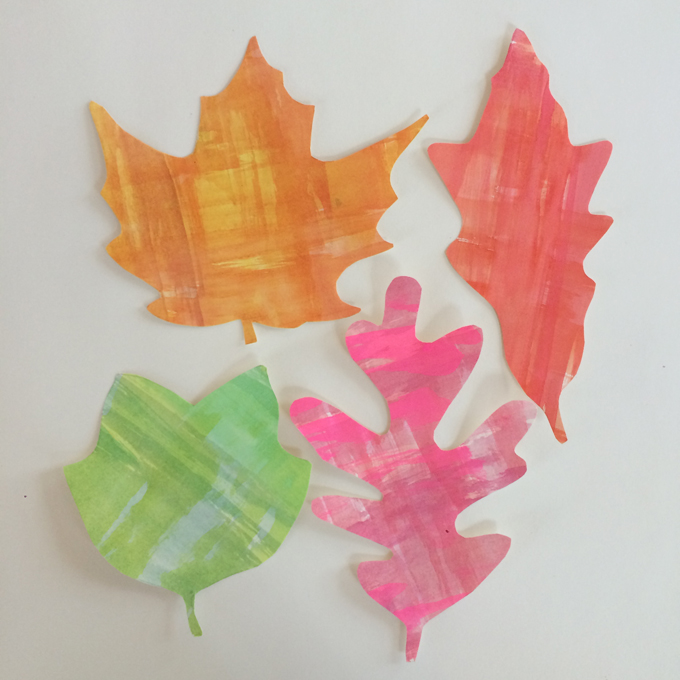 DIY leaf place cards for Thanksgiving made with watercolors and free printable stencils.