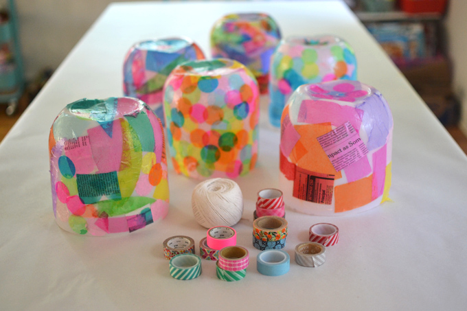 Kids make colorful lanterns from giant mayonnaise jars.