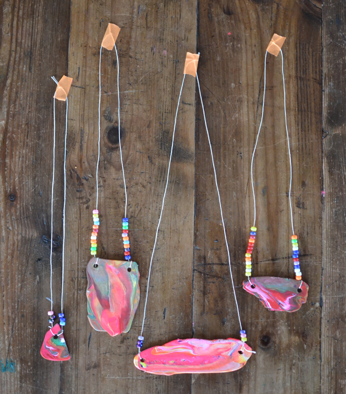Kids make marbled polymer clay necklaces with this one awesome tool.