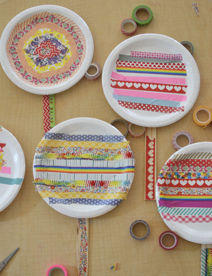 Kids use paper plates and washi tape to make big lollipops. Or they can be paddles for a balloon game!