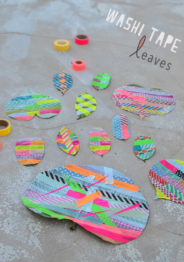 Kids use washi tape to decorate big leaves.