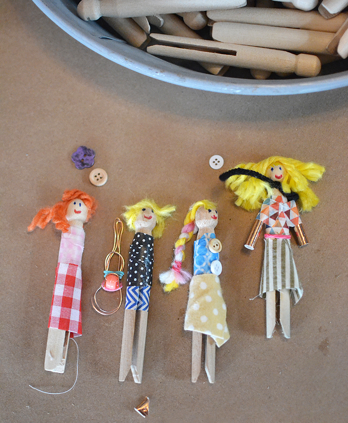 Kids make little people from clothespins and fabric scraps.