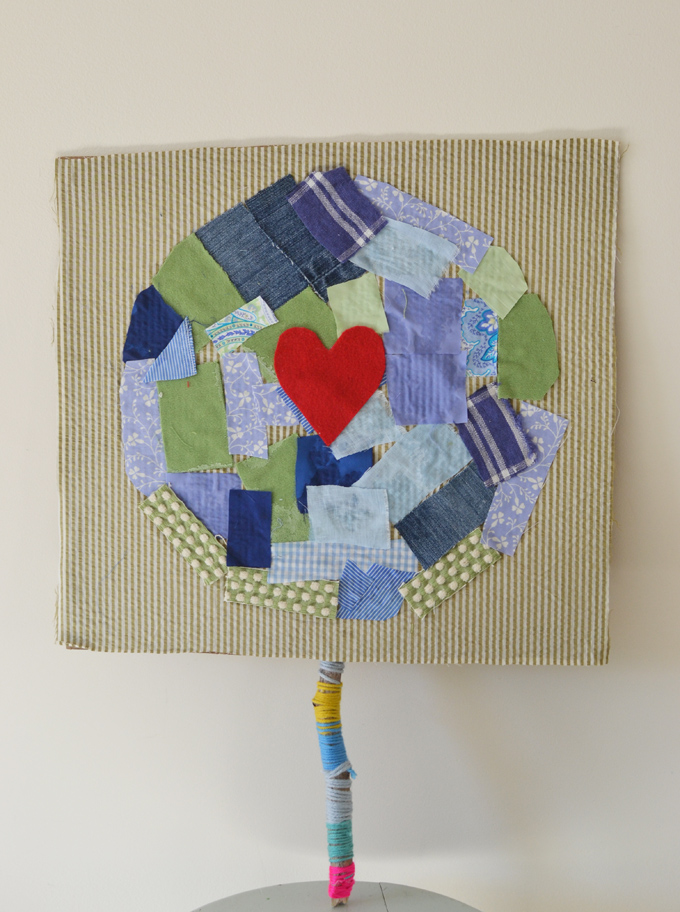 Kids make Earth Day signs using recycled and repurposed materials.