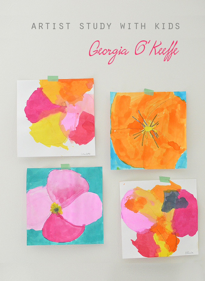 Kids paint flowers with watercolors in the style of Georgia O'Keeffe.