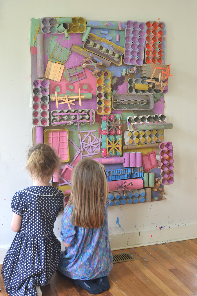 Kids make and paint a giant, 3D collage from recycled materials.