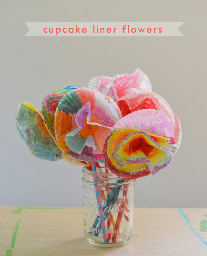 Kids make flower bouquets from cupcake liners and straws.
