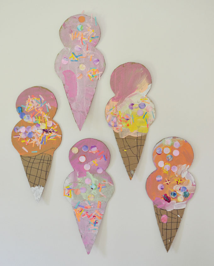 Kids make giant ice cream cones from cardboard.