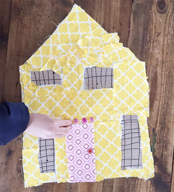 Kids make patchwork houses from cardboard and fabric scraps.
